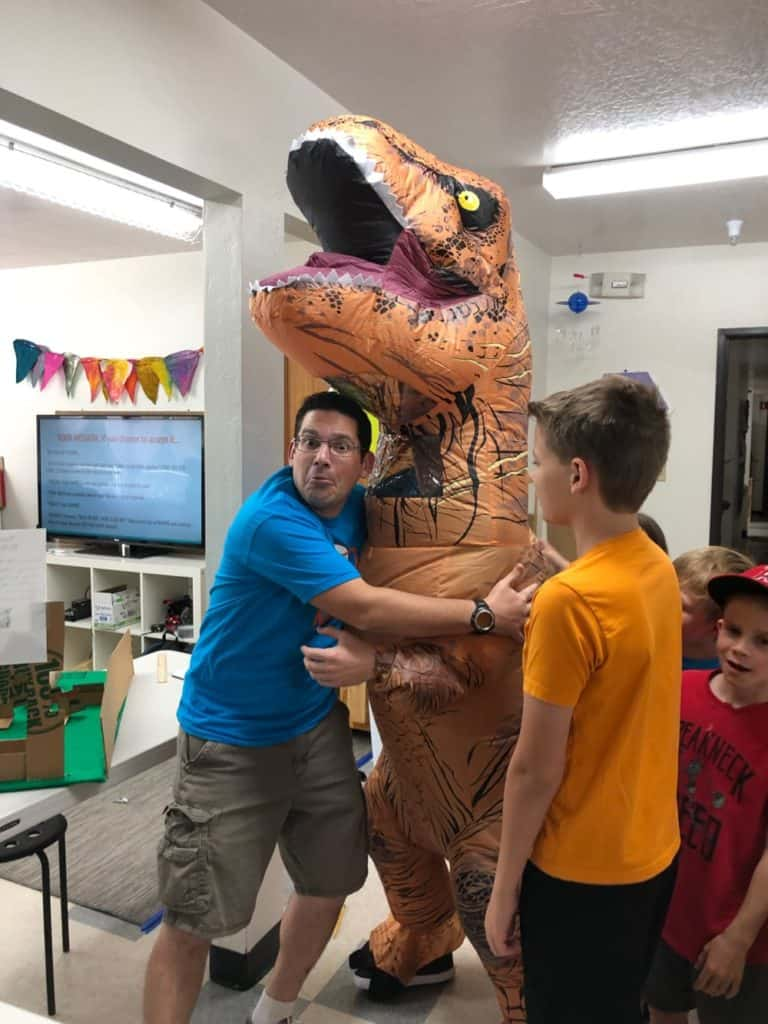 Mr Carras hugging a T-Rex